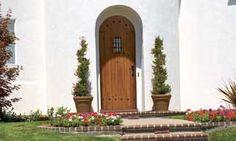 Knotty Alder wood front door round top plank with clavos and speakeasy