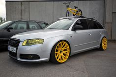 Crazy yellow rimmed Audi wagon