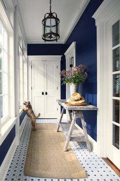 Bold and Memorable Entryways Bold and Memorable Entryways Use your entryway to make a lasting impression. A combination like navy and white is classic, yet bold and memorable. (WALL) Old Navy Aura®, Eggshell (TRIM) Simply White Aura®, Semi-Gloss Blue Hallway Paint, Entryway Paint Colors, Blue Painted Walls, White Hallway, Navy Blue Walls, Dark Blue Hallway, Blue Room Paint, Hallway Colors, Navy Blue Rooms