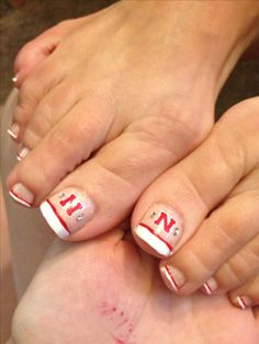 Nebraska Husker toenail design!
