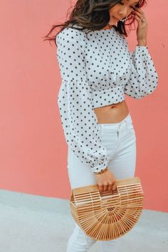 Hoang-Kim wears a polka dot crop top with white jeans and Cult Gaia bamboo bag Cropped Tops, Crop Top Design, Stylish Outfits, Fashion Outfits, Fashion Trends, Polka Dot Crop Tops, White Crop Tops, Dots Fashion, Sleeves Designs For Dresses