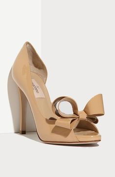 A bold oversized bow tops the peep toe of a glossy patent leather pump with a curvy d'Orsay cutout at the side of these gorgeous Valentino Couture Bow d'Orsay Pumps. #shoes