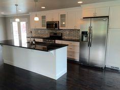 White kitchen cabinets new caledonia granite countertop for Bethel kitchen designs