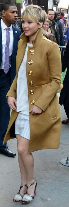 Jennifer Lawrence: Coat – Burberry  Shirt and skirt – Thakoon  Shoes – Narciso Rodriguez