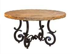 """This thick hand forged metal base has a Spanish influence with its use of curves. A natural stone or concrete top will allow this table to be used outdoors on a patio or terrace. The design can be made any size needed from 42"""" to 72"""". Notice the size of the metal legs - this"""