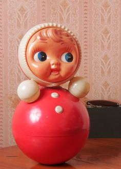 "This classic Soviet toy was designed to stay upright via a mysterious, self-stabilizing mechanism held within its bright, bulbous belly. When titled by a child, Nevalashka (""One-that-won't-lay-down"") would gently rock back, making a subdued ting-a-ling sound. Every time."