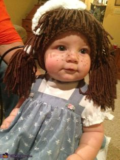 Gina: This is my daughter Ellie Mae wearing her cabbage patch doll costume! She is 8 1/2 months old. My husband came up with the idea of putting Ellie in some...