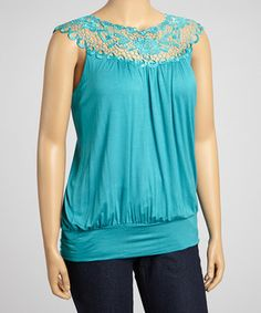 Put on this laid-back, fashionable top for a fit that flatters. Lace decorates the yolk collar and complements curves in a darling design destined to become a wardrobe favorite.