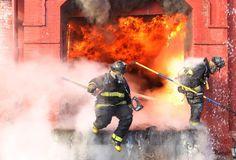 St. Louis firefighters battle four alarm fire in warehouse