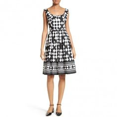 --evaChic--This Kate Spade New York Lantern Print Scoop Neck Dress features a sharp graphic motif and a fit & flare silhouette accented with a softly pleated band along the scoop neckline. The 50s-inspired silhouette is ever-flattering and signature of this sophisticated girly line. The crisp cotton dress is a day-to-evening stunner.   https://www.evachic.com/product/kate-spade-new-york-lantern-print-scoop-neck-dress/