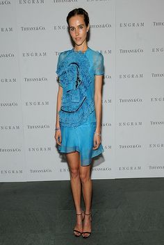 Don't mean to be horrid but she really looks like she needs a good feed. The dress is awful with all the lace & frills, not to mention the black lace or beading or whatever it is.   Isabel Lucas at the 'Engram' New York screening.