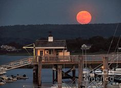 Super Moon over the harbor in Plymouth, Massachusetts on June 23, 2013