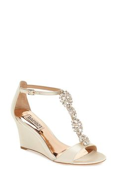 Free shipping and returns on Badgley Mischka 'Lovely' Embellished Wedge Sandal (Women) at Nordstrom.com. A dazzling quartet of crystal brooches dials up the glamour on an elegant T-strap sandal shaped from lustrous satin and lifted by a wrapped wedge heel.