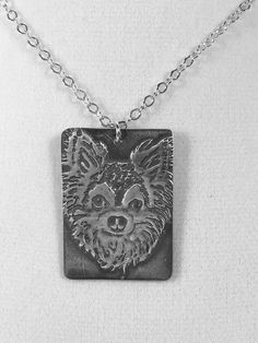 """Once I receive your photographs, I will create a line drawing from your photo using a digital art pen and tablet which will be used for the fabrication of your necklace.  The pet portrait pendant is made from pure fine silver (.999), is about 1 1/2"""" (38mm) by 1"""" (25mm) and hangs on a 18"""" sterling silver (.925) chain."""