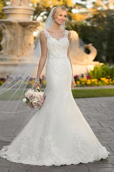 This Lace over wedding gown from the Stella York features a lovely trumpet silhouette that is both slimming and romantic.