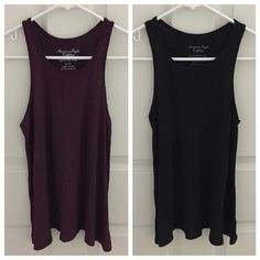 DEAL!!! TWO Trapeze Tanks TWO!!! American Eagle Outfitters trapeze tanks in black and dark purple. The dark purple has a shimmer to the fabric. Both XS, but they are flowy so they fit a size S as well. Super cute and are very flattering! Barely worn, great condition! Great value! American Eagle Outfitters Tops Tank Tops