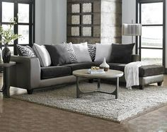 Grey sectional with chaise! (I might be purchasing this today for the living room) also I love that greywashed round wood coffee table!