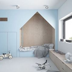Built in house nook in kids room with light blue walls