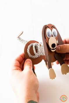 glue each end onto the two body parts of Slinky Dog. The two ends should now be connected and once the glue is dried you can stretch and squish Slinky like a real slinky dog!