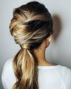 Pretty twisted ponytail with Aveda brunette balayage hair color by Aveda Artist Anna Nordby at Juut Salonspa.
