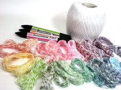 Make your own bakers twine.  http://thefrugalcrafter.wordpress.com/2011/04/19/make-your-own-bakers-twine/