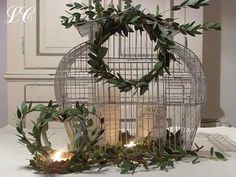 my birdcage needs a boxwood wreath and a candle in it…done :)