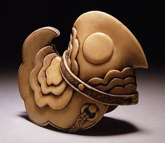 Japan  Bugaku Bird Headdress, early 19th century  Netsuke, Ivory with staining, sumi. LACMA