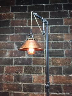 This industrial floor lamp was designed with versatility in mind. The fixture has a built in adjustable pendant that can be set to your desired height and easily changed whenever you wish. This simple industrial pendant lamp is full of character and vintage charm. It starts with the 8″ unfinished copper shade. The metal cone comes with a distressed and weathered appearance by design but can easily be cleaned up for a more elegant look.