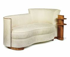 A rosewood and velvet chaise lounge by Jules Leleu, commissioned for the SS Normandie circa 1935
