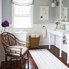Our Dash and Albert Swedish Stripe rug is the perfect complement to the clean and classic details of this 1920s-era cottage bathroom from @traditionalhome.