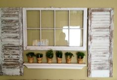 Shabby Chic...Old window & shutters make a nice wall display.