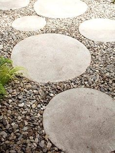 stepping stones -- can make it look like polka dots in the yard... big and small and different colors