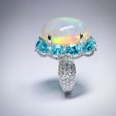 When an opal meets paraiba, love happens! A 24.94 carat opal, blends harmoniously with 8.16 carats of paraiba tourmaline, nestling in over 2.50 carats of white diamonds. A match made in heaven  @karen.suen ...
