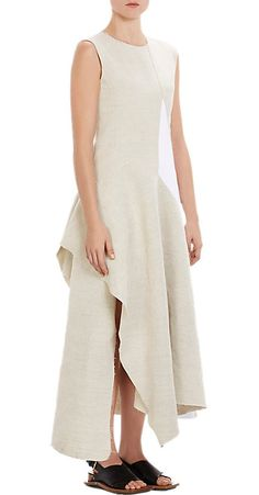 """Jewel neckline, contoured seaming at front and back, asymmetric skirt panel wraps to back and hangs freely, cutaway open side slit, raw-seamed edges, handkerchief hem, white industrial zipper 51.5"""" to 56.0"""" from shoulder to hem, approximately Exposed back zip Available in Beige/White Cotton/linen Dry clean Made in Italy"""
