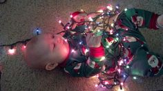 Baby boy (closely monitored) with Christmas lights makes a wonderful picture!