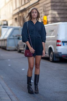 Blue silk shirt + dark high waisted shorts + high black boots