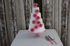 Rebecca: 4-tier White Wedding Cake with Coral Pink Handmade Roses and piped pearl details