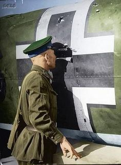 Soviet Soldiers during WW2 - checking out a German plane
