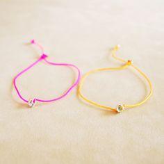 Cristina Zazo SS14, Point bracelets - blue topaz and rose string, peridot and orange string #cristinazazo #bracelet #bluetopaz #peridot