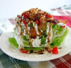 Let me just say that I call this wedge salad a delicious mess! Yes, yes, I do! It may not look pretty, but oh my does it taste good! Wedge salads started appearing on restaurant menus just a few years ago and the best ones are those dressed with a really good blue cheese dressing …