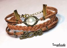 A personal favorite from my Etsy shop https://www.etsy.com/listing/211243385/brown-leather-and-brass-love-bracelet