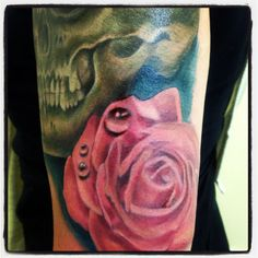 Scull and roses tattoo in progress
