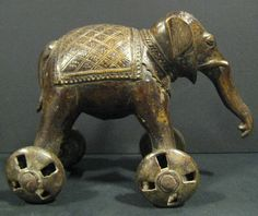 Indian Elephant on Wheels - Origin: India Circa: 1850 AD to 1920 AD Antique Toys, Antique Art, Vintage Toys, Sculptures, Lion Sculpture, Elephant Illustration, Vintage Board Games, Folk, Indian Elephant