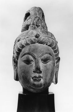 This head of Guanyin (Kuanyin) has a small Amitabha Buddha in the headdress. The tip of the nose and the ends of the ear lobes are broken off.
