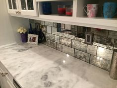 bonitaglassshoppe antique mirror backsplash was installed in a truly unique fashion. To add interest, the tiles were cut in various sizes. As you can see in the photo, not just one antique mirror pattern was used. For this backsplash we used 8 different patterns. The client selected the patterns and specified which were her favorite. The favorite antique patterns were used the most, with splashes of different patterns mixed in. To further the antique look, a dark grout was used in between…