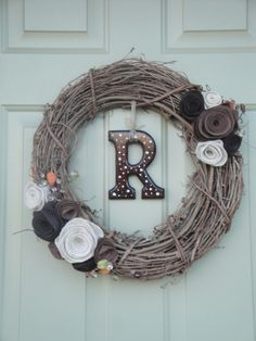 make a felt flower wreath and do a good enough job to hang it on my front door