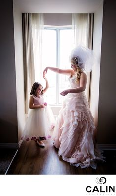 Photography by Calin - flower girl and bride one king west wedding: While the bride was getting ready at One King West, the flower girl was looking pensive. I asked the bride to give the little girl a twirl and I pressed the shutter at the right moment. . Location: 1 King Street West Toronto, ON M5H 1A1 .