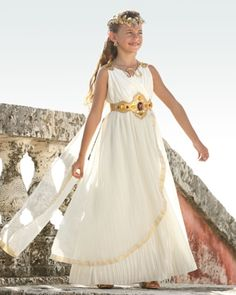 Grecian Goddess Girls Costume Exclusively Ours For centuries your beauty has inspired poets and sculptors. Dressed in a stunning gown with pleating detail and embellished trim, you wear a detachable cape that flutters in warm Mediterranean breeze. A jewel-studded belt encircles your waist. A circlet of golden leaves tops your tresses and jewelry completes the look.