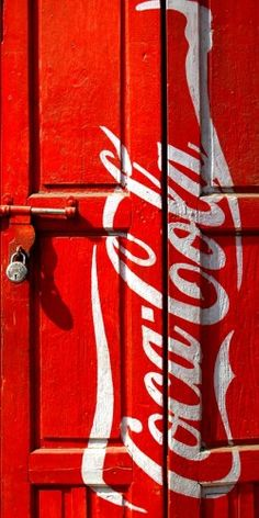 A padlocked door with the Coca Cola trademark. So what is behind the door you know it has to be Coca Cola.