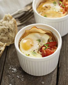 Eggs. You can poach them, boil them, fry them, and scramble them - but have you tried them baked? Low-cal, low-input and delicious - welcome to your new favorite way to eat eggs! . What you need: 2 eggs 2 slices of lean turkey ham 1 large tomato, chopped 1/2 tsp olive oil fresh parsley, for serving salt + pepper . What you do: Preheat the oven to 375° F / 200° C. Grease 2 ramekins with the olive oil. Line each ramekin with a slice of turkey ham, distribute the chopped tomato between each…